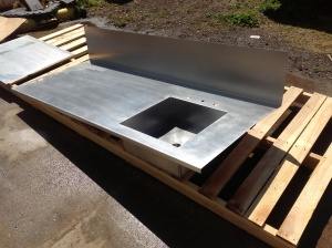 Stainless countertop with sink for a quality custom kitchen.